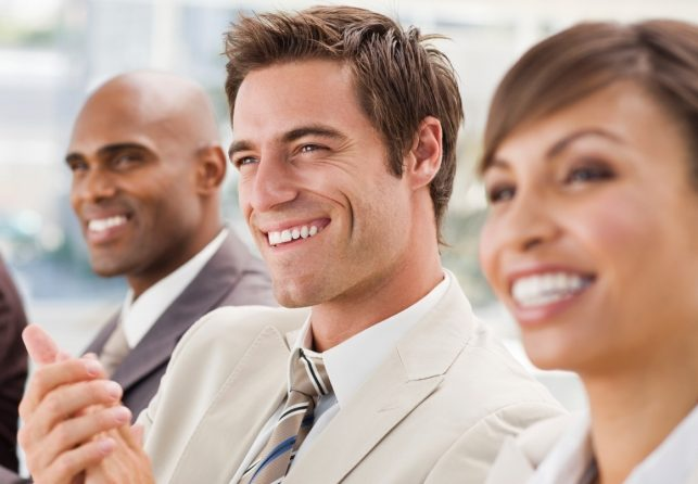 Closeup of happy businesspeople enjoying